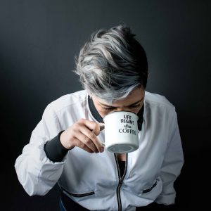 Woman drinking coffee head down